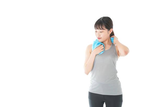 汗を拭く女性 ストックフォト
