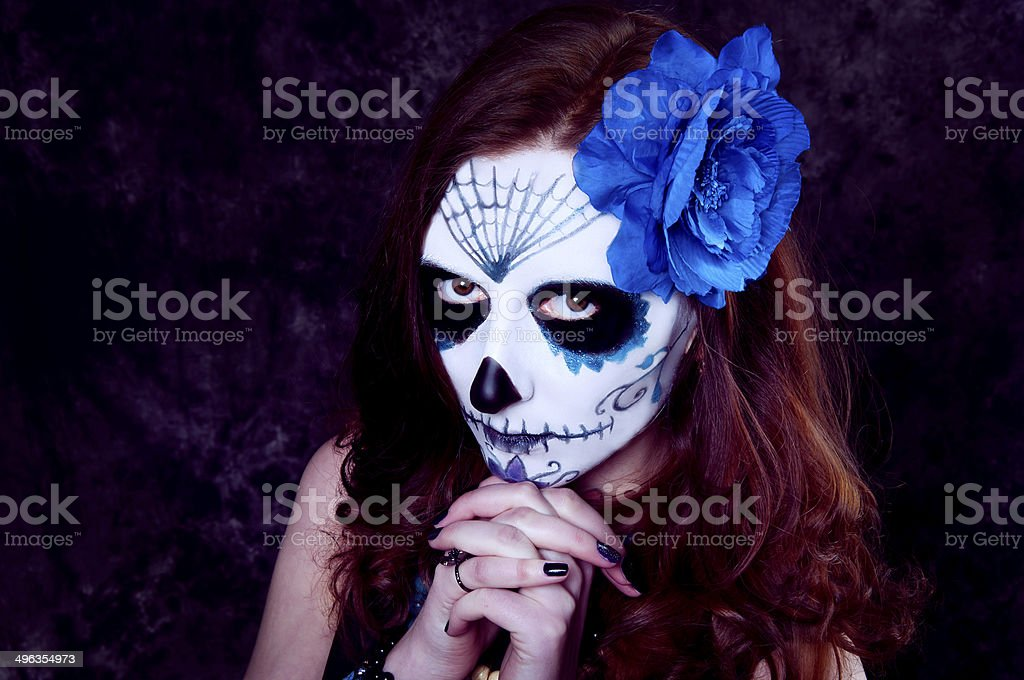 Woman witch with scary makeup.Dia de los muertos stock photo