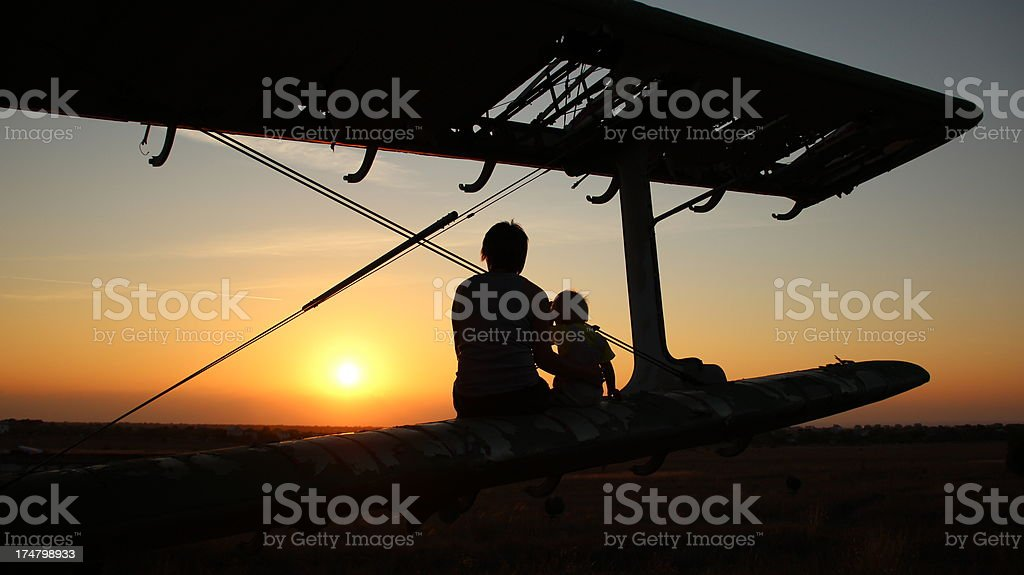 woman with a baby in the sunset royalty-free stock photo