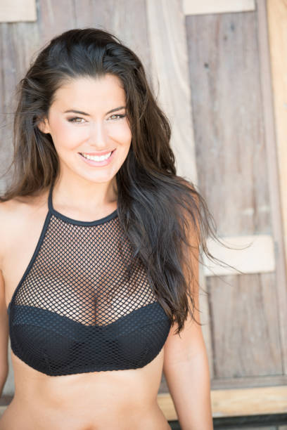 woman with a beautiful natural smile, happy vacation time, stunning portrait - busty women in bikinis stock pictures, royalty-free photos & images