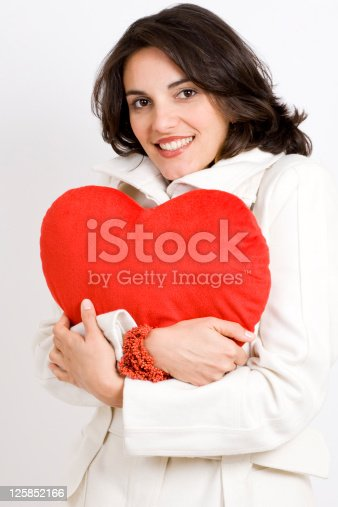 istock woman with a big red heart 125852166