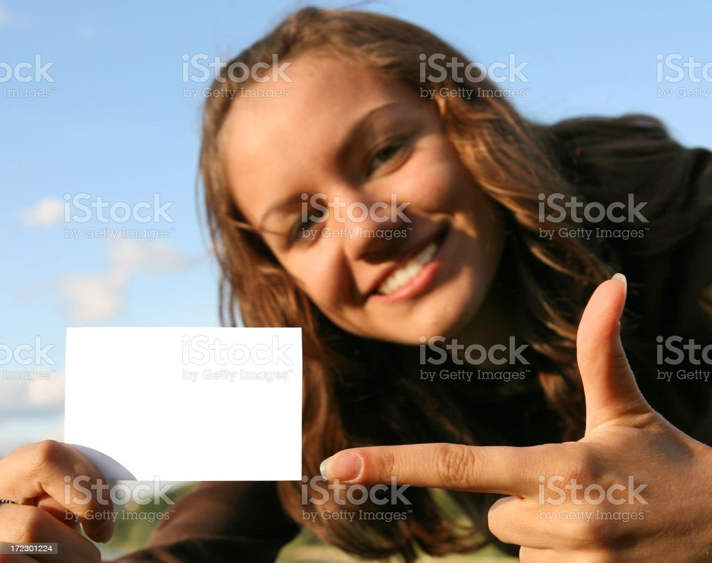 A woman with a blank business card royalty-free stock photo