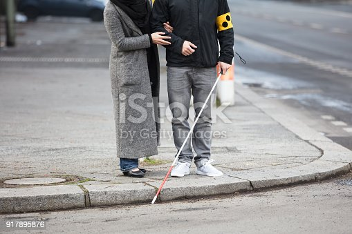 istock Woman With A Blind Man On Street 917895876