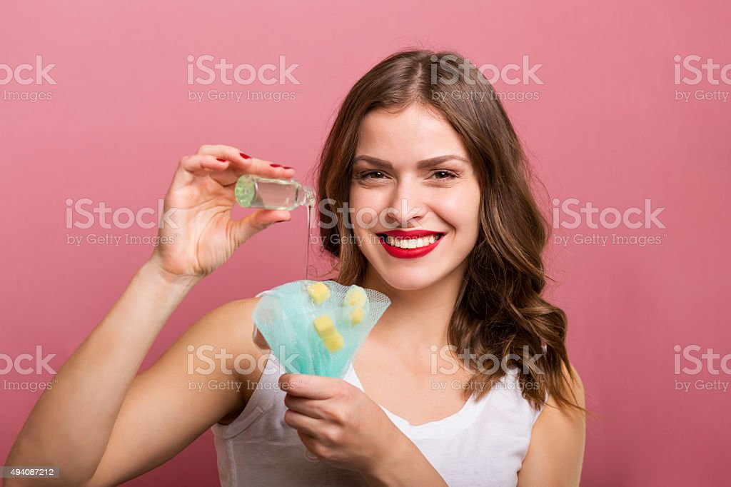 Woman with a bottle of lotion stock photo