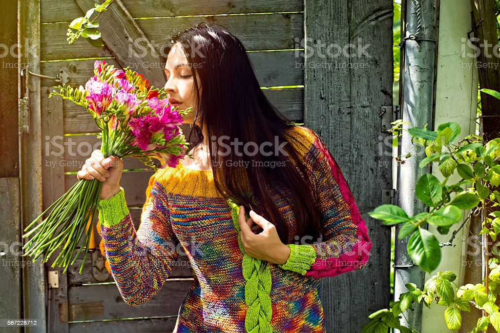 Woman with a bouquet of flowers and lovely smil stock photo