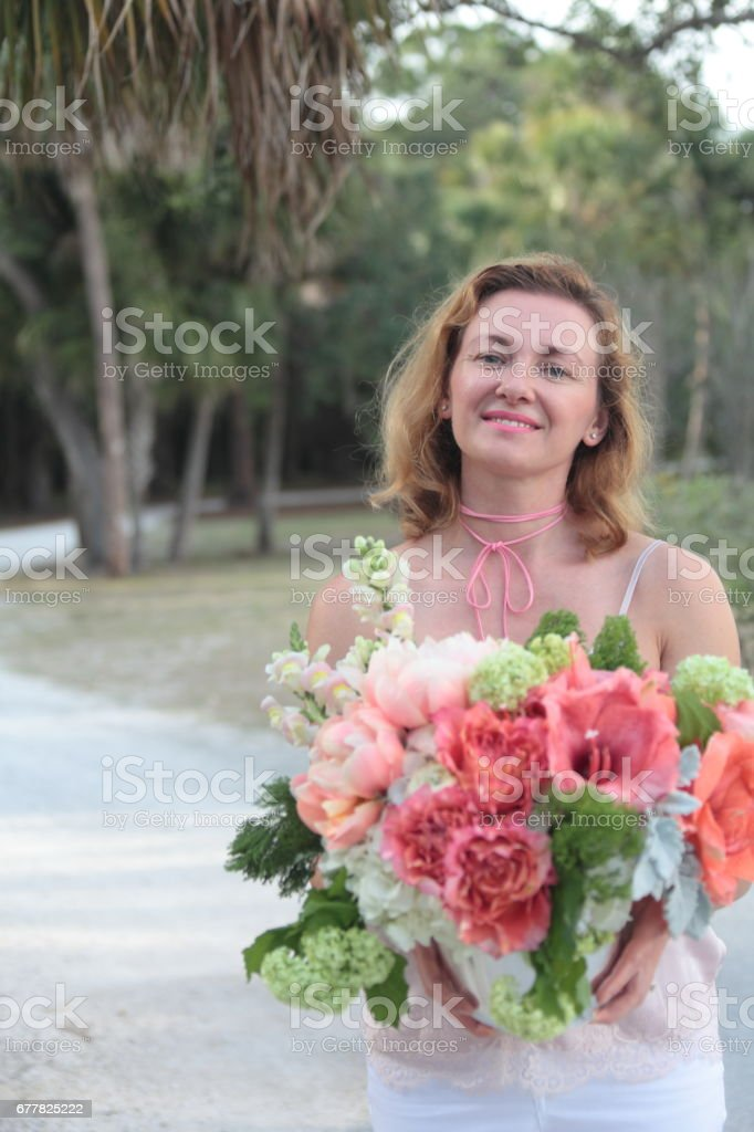 Woman with a bouquet. royalty-free stock photo