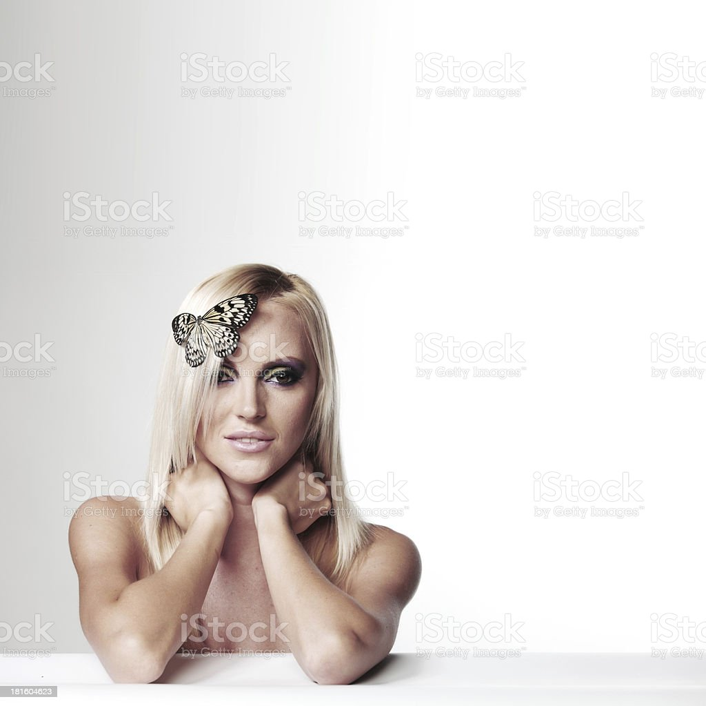 woman with a butterfly royalty-free stock photo