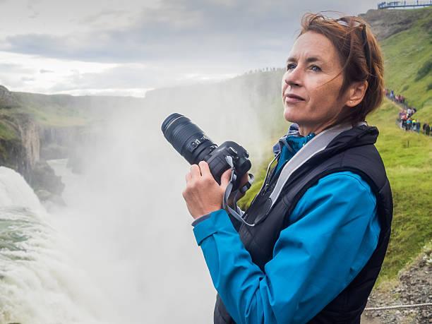 Woman with a camera at gullfoss waterfall iceland picture id614529056?b=1&k=6&m=614529056&s=612x612&w=0&h=dc hnsqkfg3gipp6xxzrpvbrwzisndm2uuxo hpwigm=
