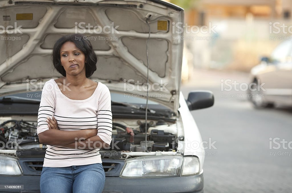 Woman with a car problem and the hood open stock photo