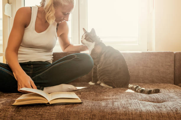 Woman with a cat by the window reading a book woman reading a book picture id872214270?b=1&k=6&m=872214270&s=612x612&w=0&h=f fvc913dum j417uuoezmrb8ejkgornymwq nushqm=