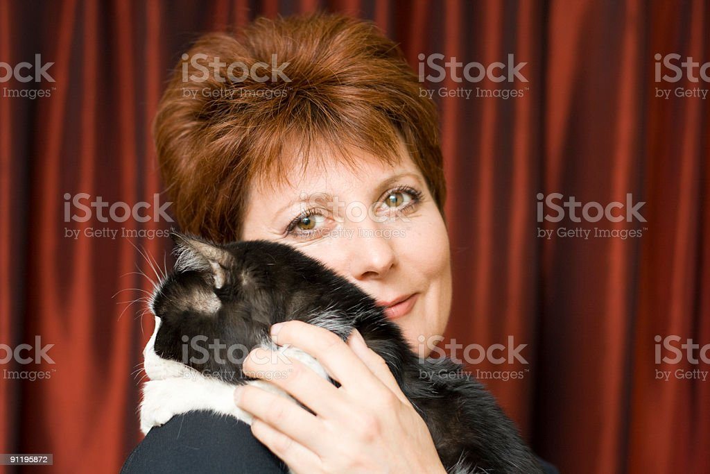 Woman with a cat royalty-free stock photo