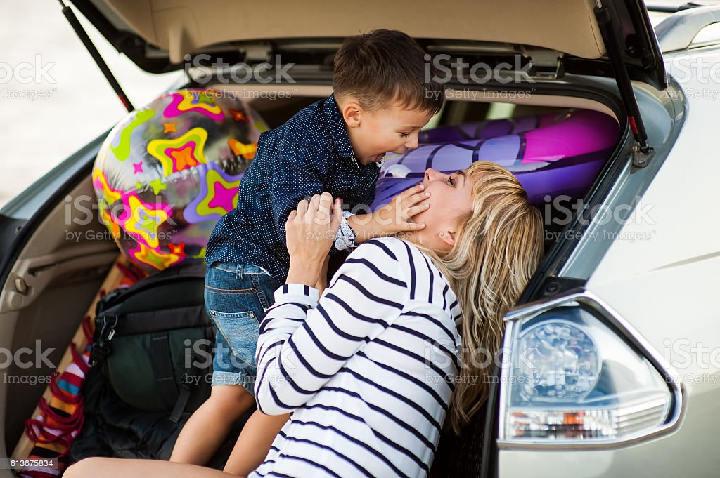 woman with a child  in the car stock photo