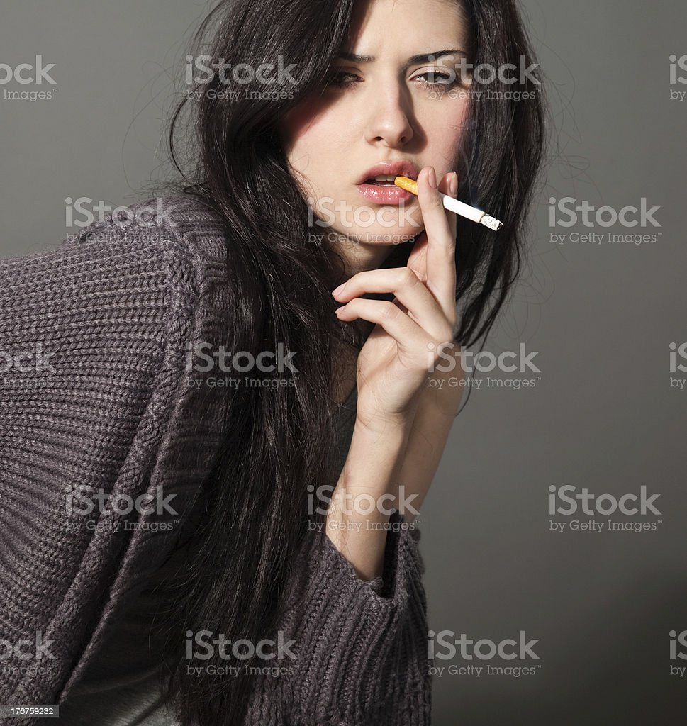 woman with a cigarette royalty-free stock photo