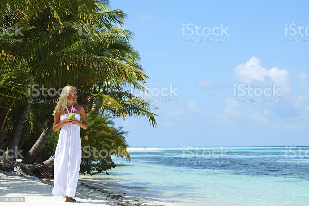 woman with a coconut cocktail royalty-free stock photo