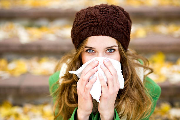 Woman with a cold Woman with a cold cold virus stock pictures, royalty-free photos & images