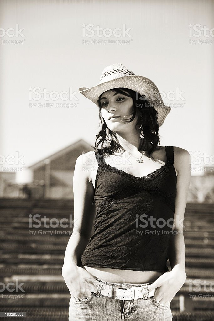 Woman with a cowboy hat (sepia) royalty-free stock photo