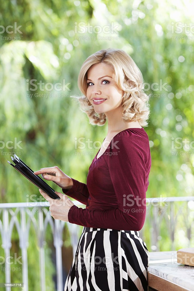 woman with a digital tablet royalty-free stock photo