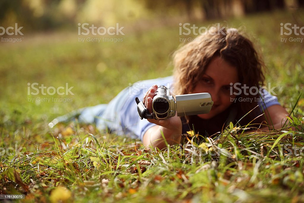 woman with a digital video camera royalty-free stock photo