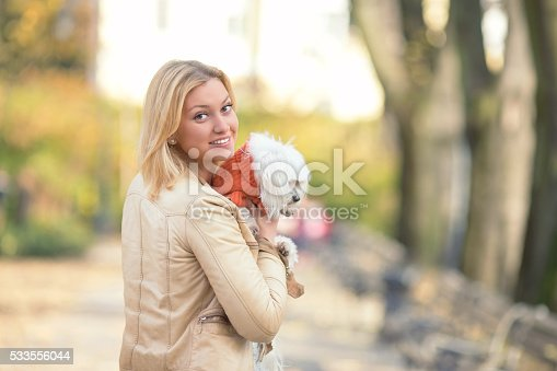 istock Woman with a Dog 533556044