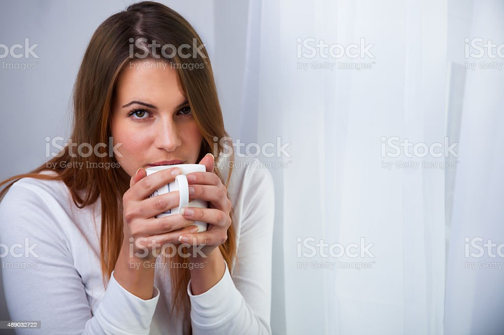 Woman with a drink stock photo