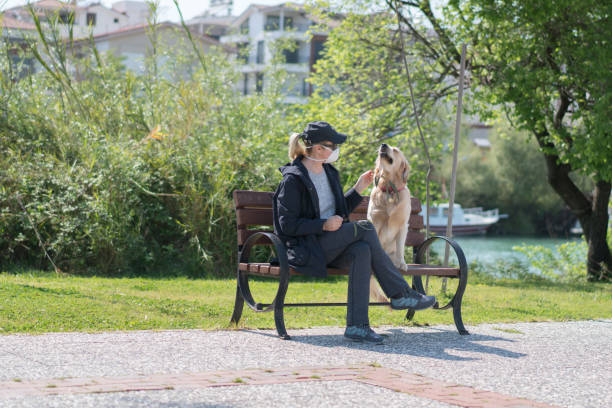 Woman with a face mask sitting her dog in park bench picture id1218220303?b=1&k=6&m=1218220303&s=612x612&w=0&h=ydfb61swi t8jmuvovam6zwbmcw4xqpusxrc3tvctfy=