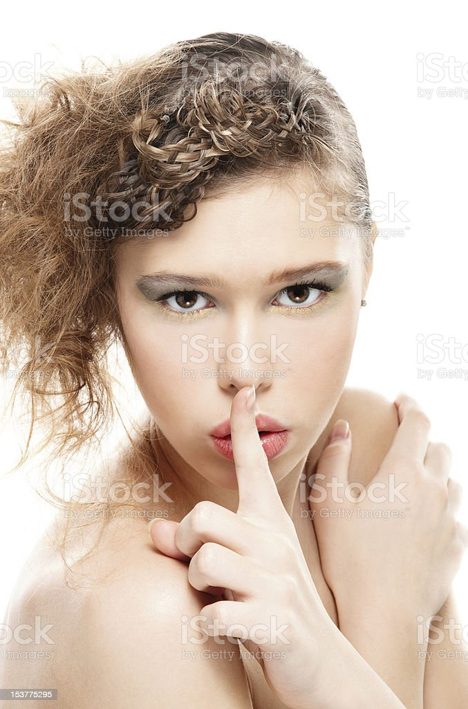Woman with a finger on lips royalty-free stock photo