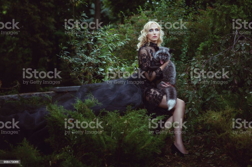 Woman with a fox. stock photo