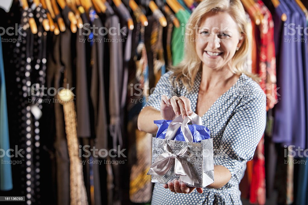 Woman with a gift bag royalty-free stock photo