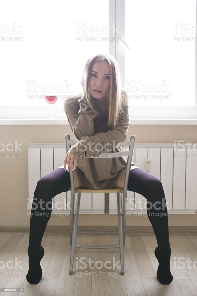 woman with a glass of red wine stock photo
