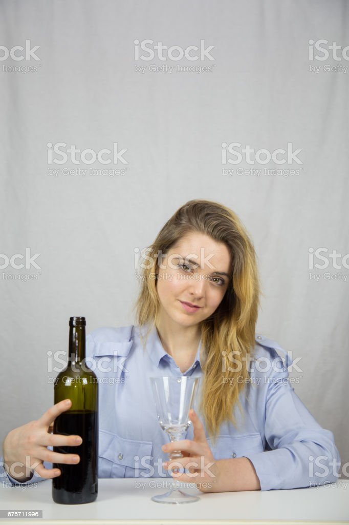 Woman with a glass of wine in her hand. 免版稅 stock photo