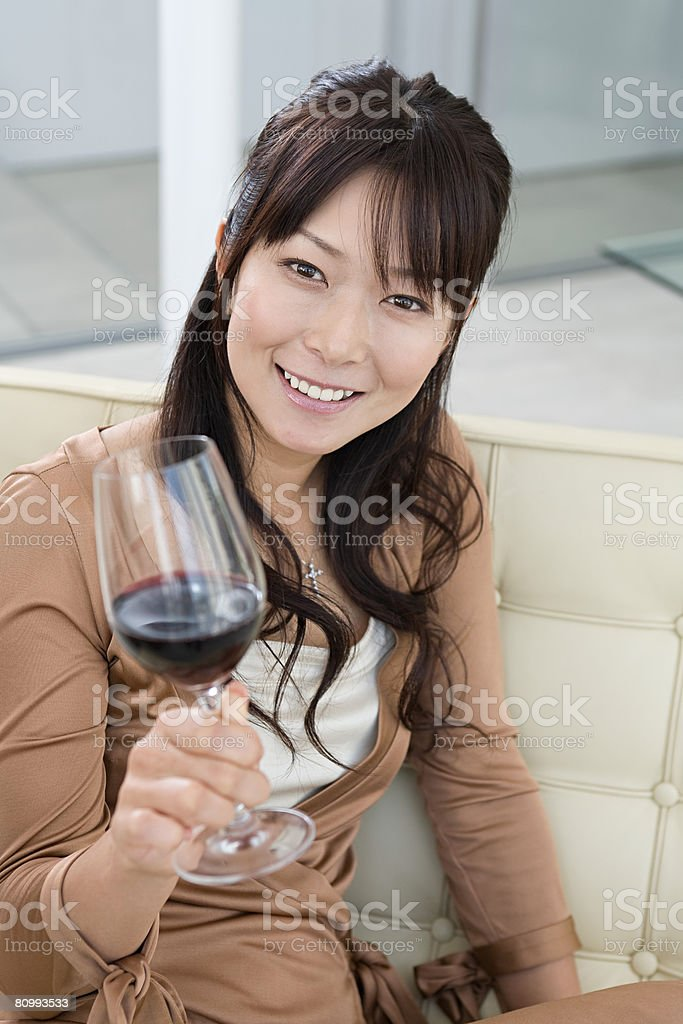 Woman with a glass of wine royalty-free stock photo