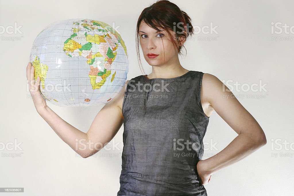 Woman with a globe, facing the camera. royalty-free stock photo