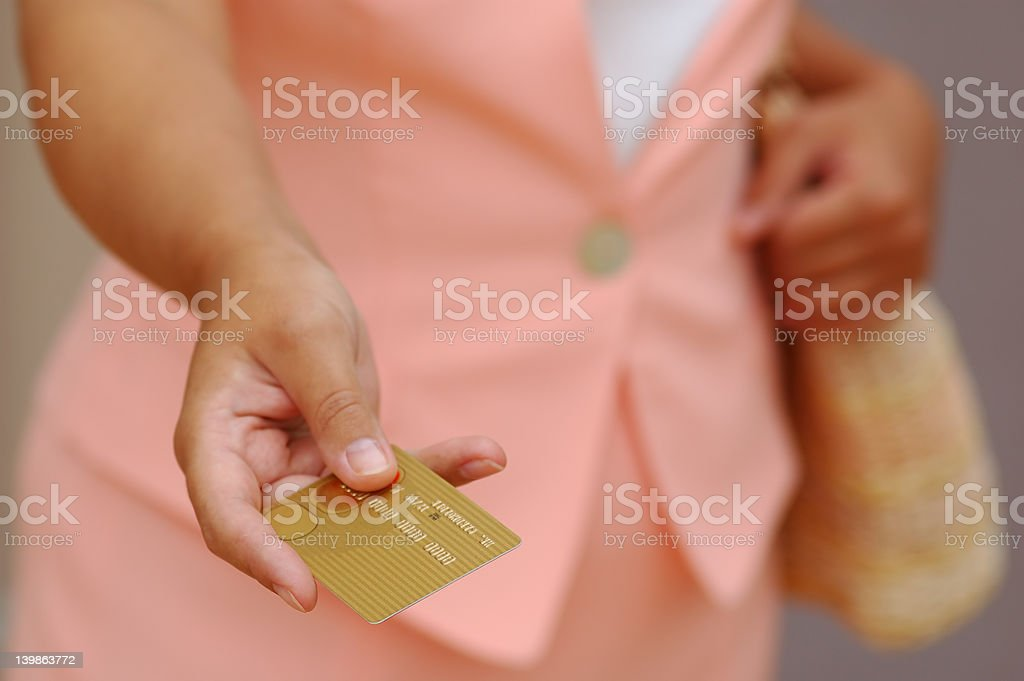 Woman With a Gold Credit Card royalty-free stock photo