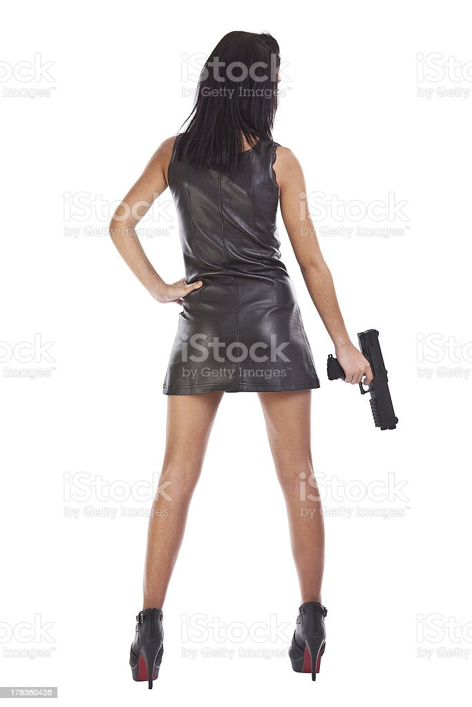 Woman with a gun in hands royalty-free stock photo