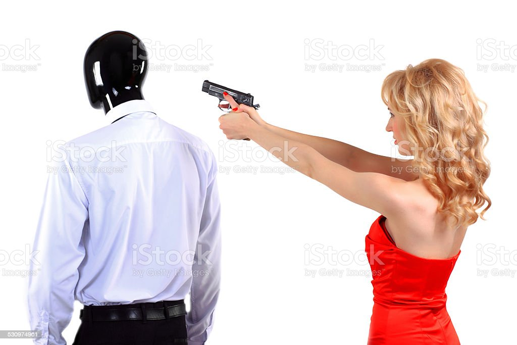 woman with a gun in his hand stock photo