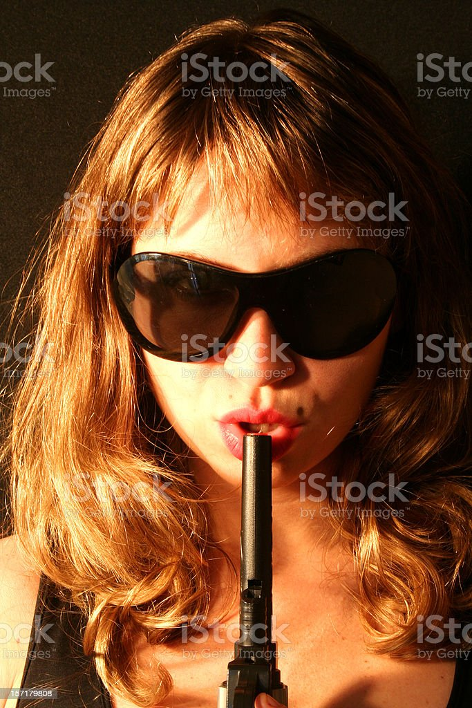 Woman with a Gun royalty-free stock photo