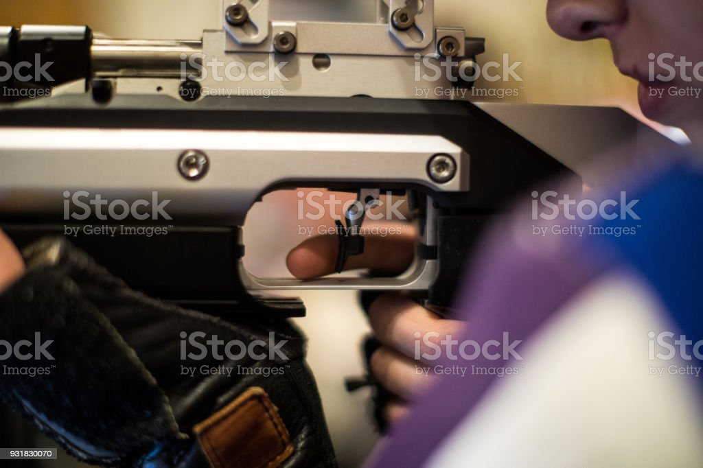 Woman With A Gun Ready To Shoot On Target Stock Photo