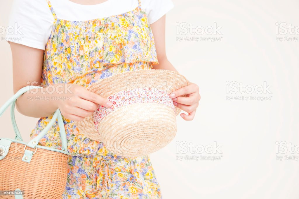 Woman with a hat and bag hand royalty-free stock photo