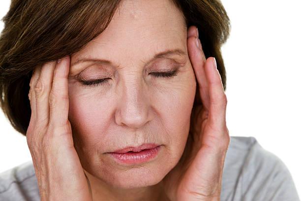 woman with a headache - mature woman fever on white bildbanksfoton och bilder