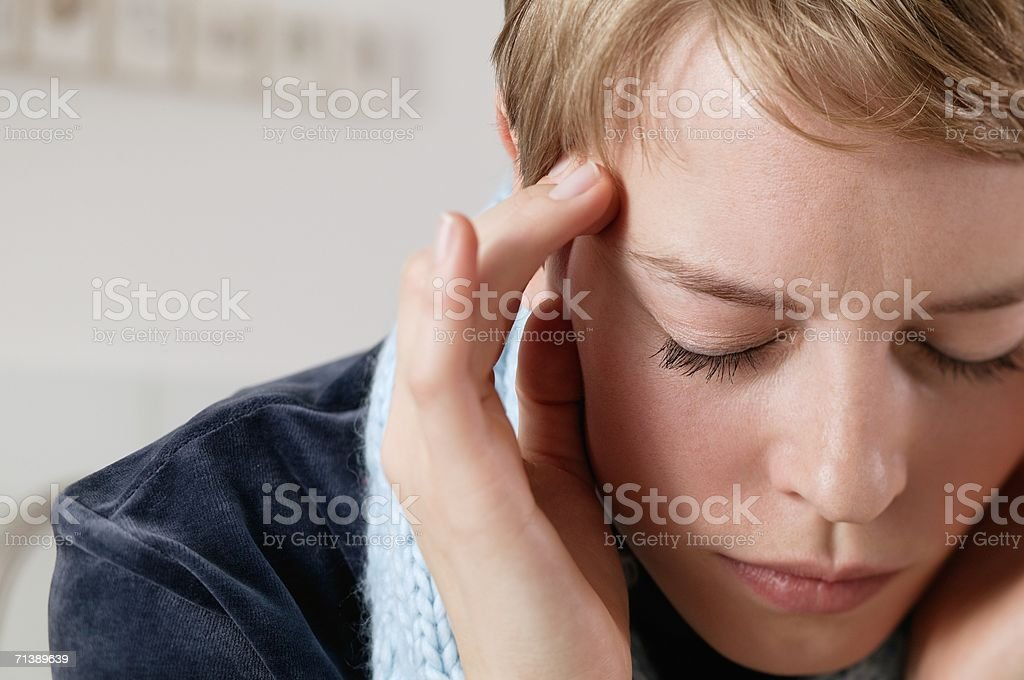 Woman with a headache royalty-free stock photo