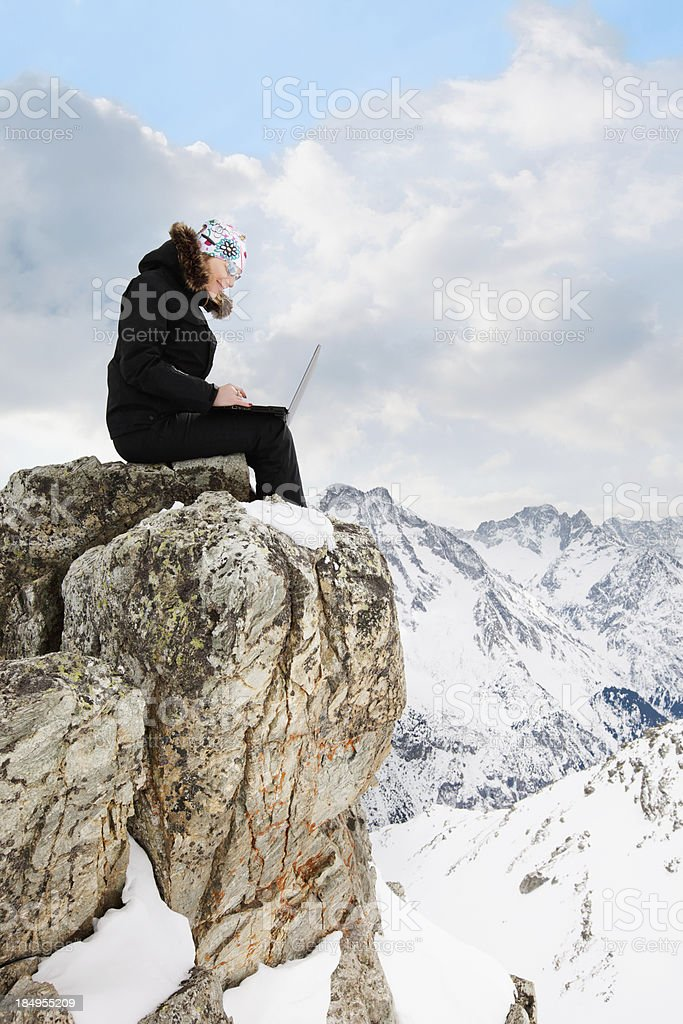 Woman with a laptop on the top stock photo