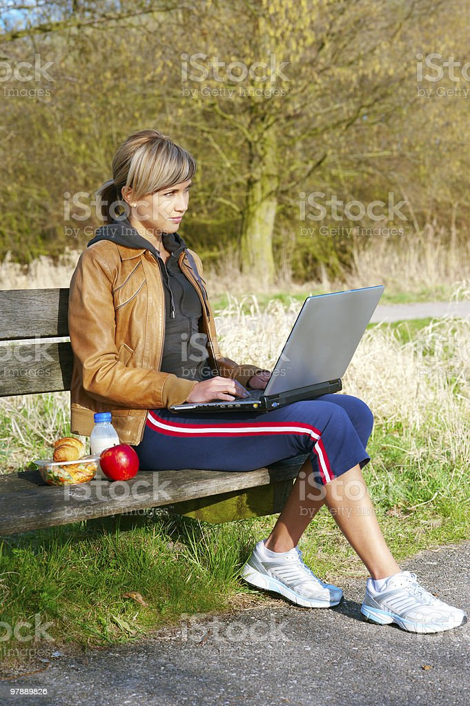Woman with a Laptop Outdoors royalty-free stock photo