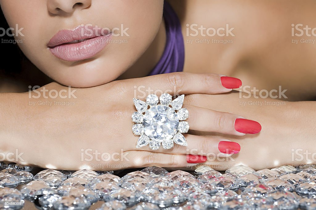 Woman with a large diamond ring stock photo