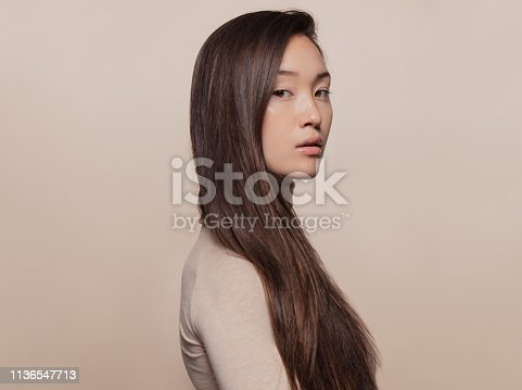 istock Woman with a long straight hair 1136547713