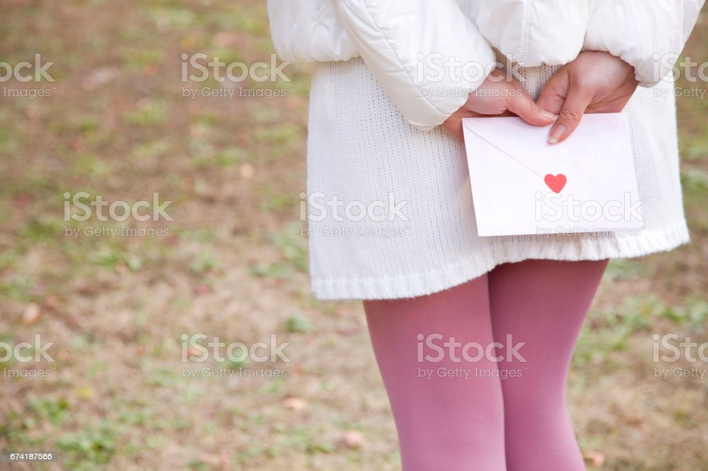 Woman with a love letter stock photo