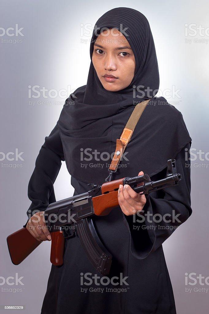 woman with a machine gun stock photo