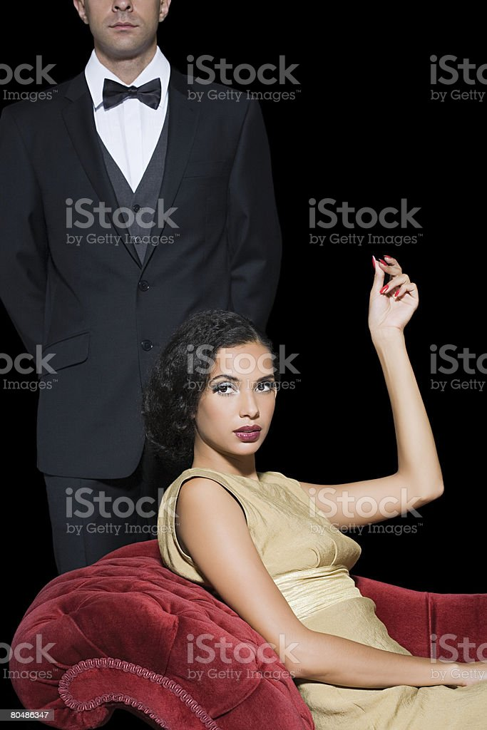 Woman with a man servant stock photo