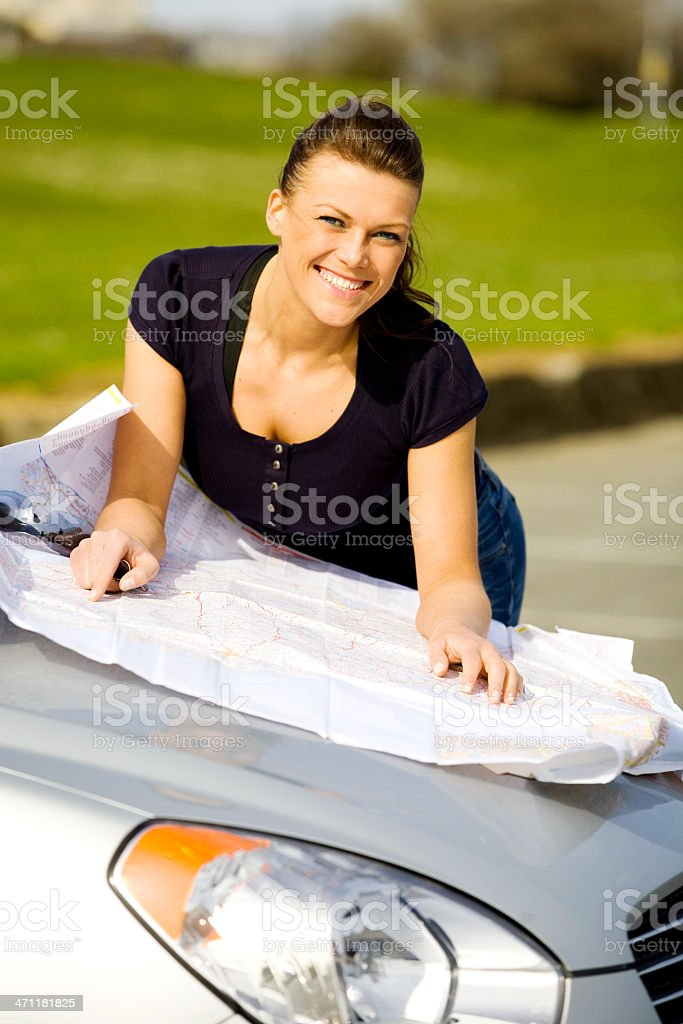Woman with a map royalty-free stock photo