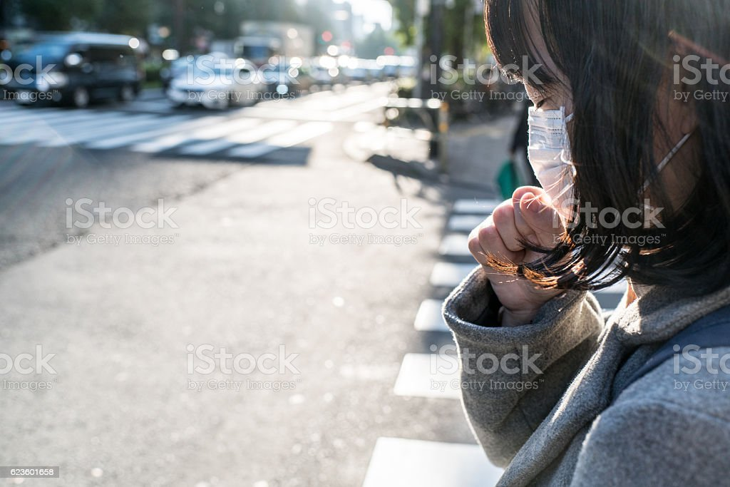 Woman with a mask coughing stock photo