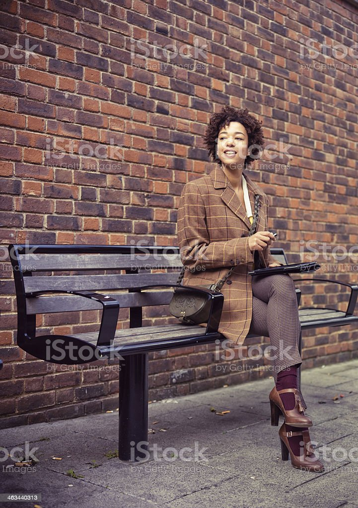 Woman  with a mobile phone and digital tablet royalty-free stock photo